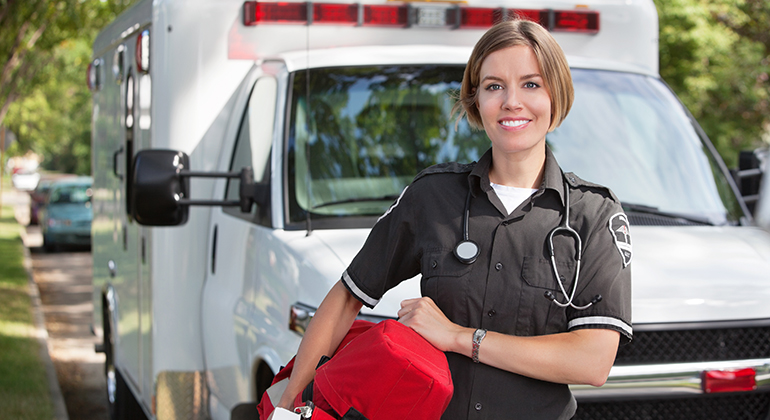 EMT in front of ambulance